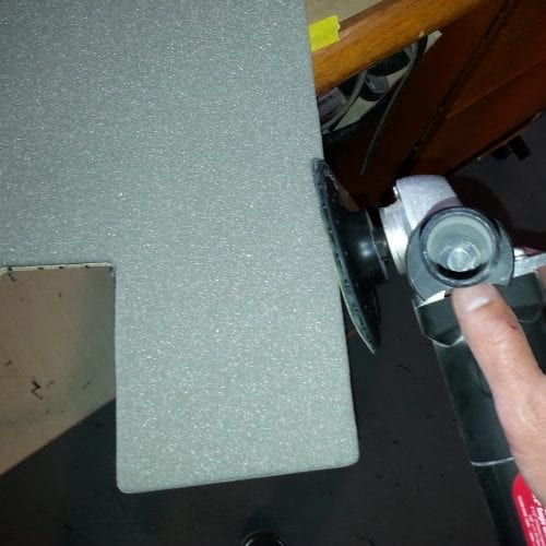 sanding edge pieces of upholstery with sander