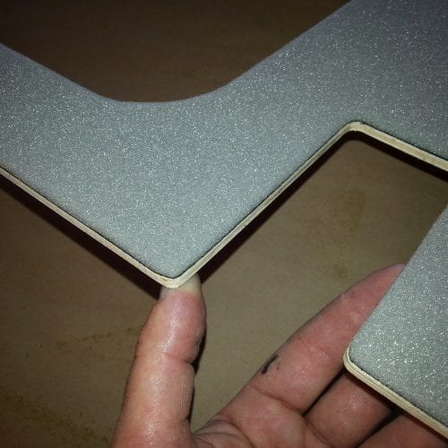 close up of smooth edges on trunk panel after upholstery was sanded