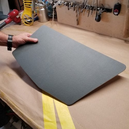 holding single trunk panel with finished upholstery