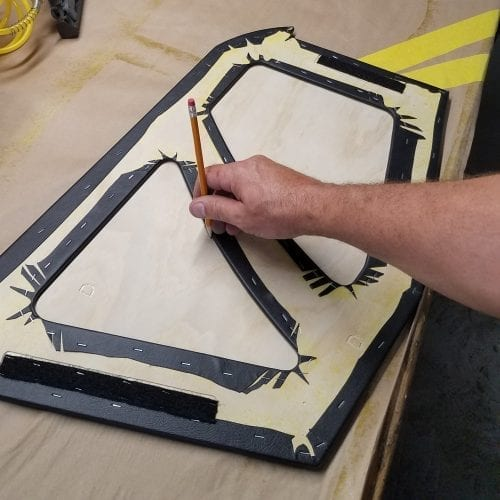 use pencil to track underneath of the backing panel