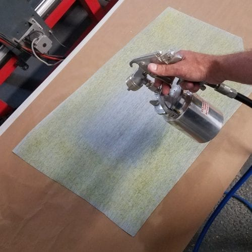 spraying adhesive to upholstery without panel