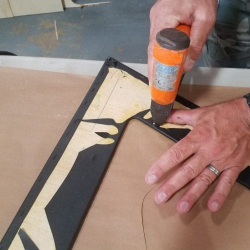 stapling inside newly glued corners to back of trunk panel