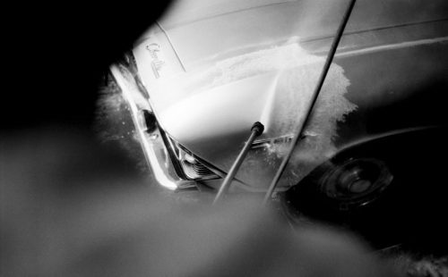 blurred man using car show preparation tips to wash chevelle